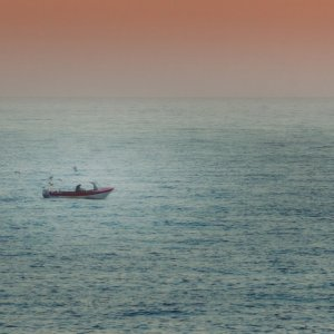 Isolated boat off the coast of Cromer